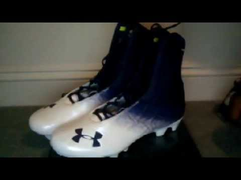 Under Armor Highlights Purple And White Football Cleats.