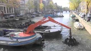 Fishing sunken bicycles in Amsterdam canal