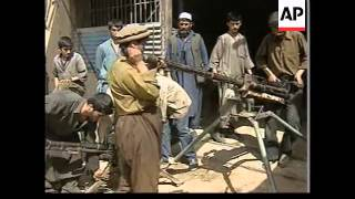 Repair shops in northern Afghanistan fixing weapons.