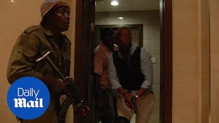 Armed members of Kenyan police squad storm Nairobi hotel after attack