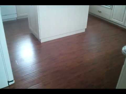 Hand Scraped Teak Wood Laminate Flooring Floated Over Existing Tile