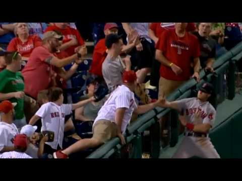 Andrew Benintendi reaches into the crowd for catch