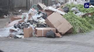 ازمة تراكم النفايات في سوق الخضار المركزي في اربد