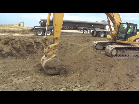 Caterpillar 345CL Excavating and Loading SideDumps on a Earth Moving Project In Troy, IL.