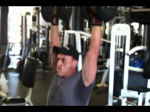 Marc Nadeau performing DB Press for shoulders.