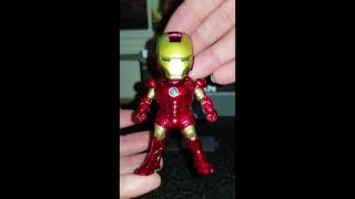 Miniature iron man figures from wish unboxing.