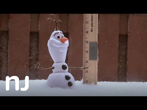 Measuring the snowfall with Olaf from Disney's Frozen