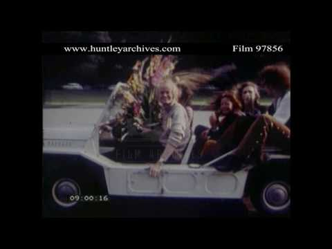 Rolling Stones amused by Mini Moke as it passes their limo.  Archive film 97856