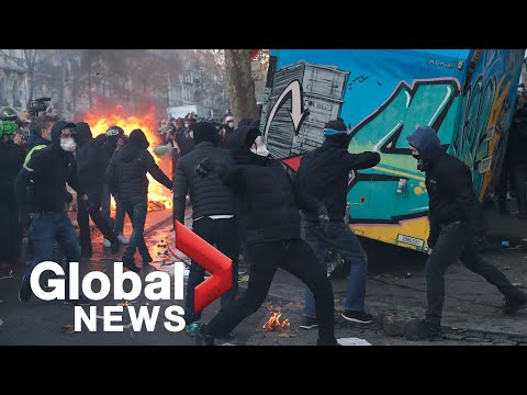 Tear gas, fires as thousands protest in Paris against police violence, security bill
