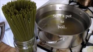 Spinach Spaghetti With Pesto Sauce.