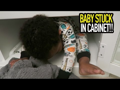 BABY STUCK IN CABINET!!
