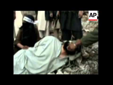 Afghanistan - Militant Video Shows Boy Beheading Alleged Taliban Traitor