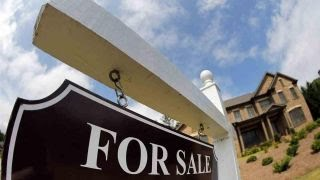 Home sales stumble as prices reach record highs