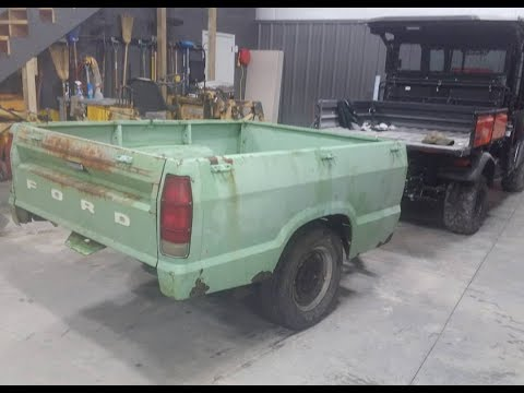 building a homemade dump trailer out of a truck bed trailer PT 1.