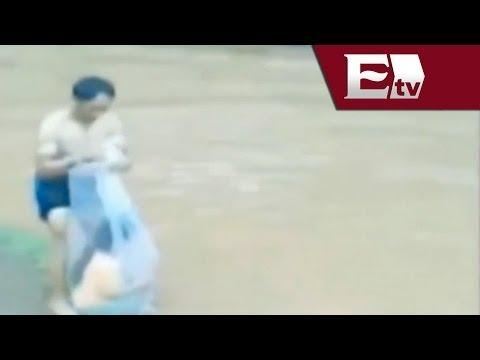Video Cruzan A Ninos En Bolsas De Plastico Por Rio De Vietnam