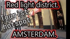 "Downtown Amsterdam tourist area ""Red Light District"".  Over de Wallen. Bike cam. Sexworkers Mokum."