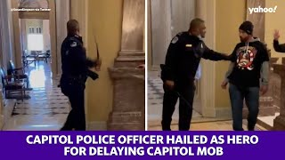 Capitol police officer hailed as hero for delaying Capitol mob