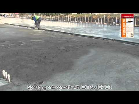 Broadcasting EXTRA-TOP CR onto fresh concrete by ISOMAT S.A.
