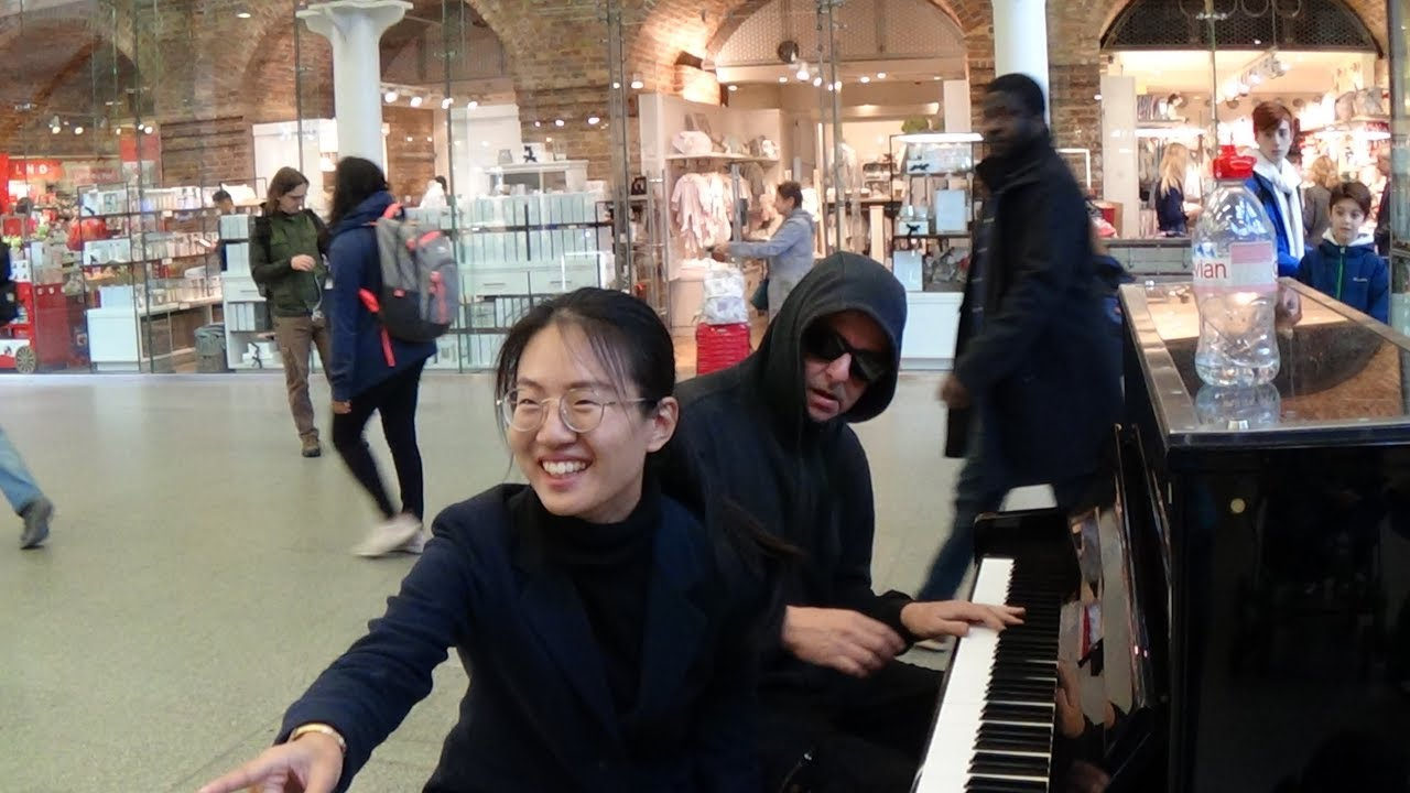 Authoritative asian pianist young boy