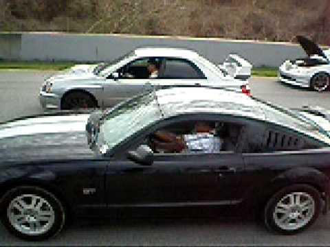 Stock Subaru WRX STI vs 2007 Supercharged Mustang GT