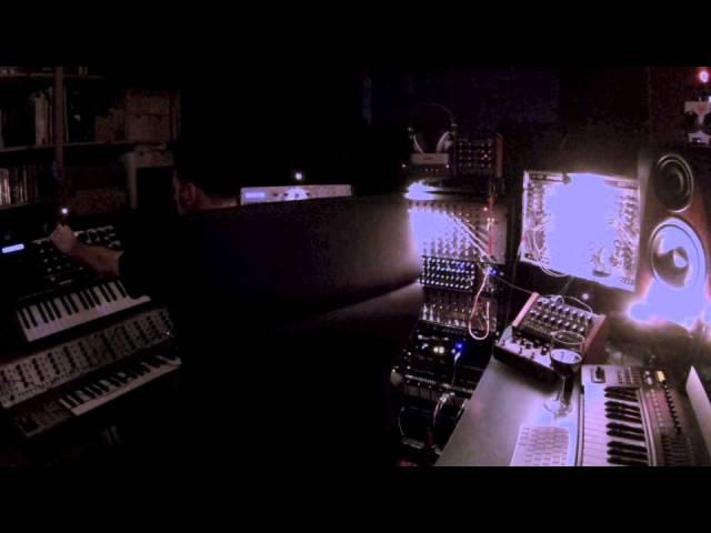 Gin Devo composing electronic industrial tracks in Vomito Negro studio