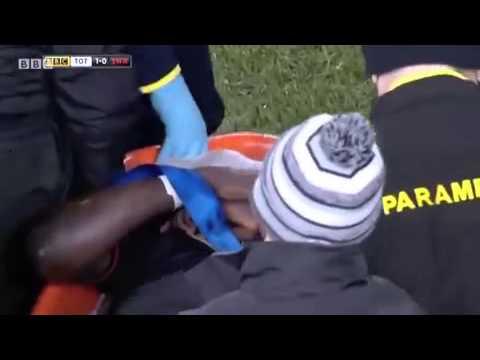 Swansea's Bafetimbi Gomis collapses...