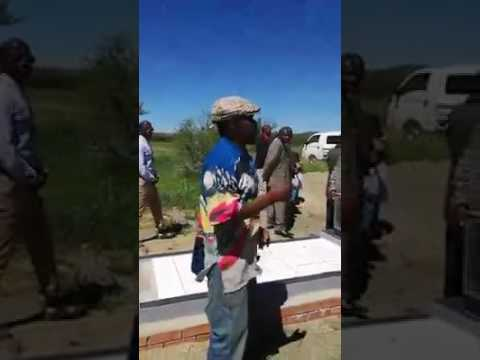"A drunk man singing ""noyana"" at a funeral"