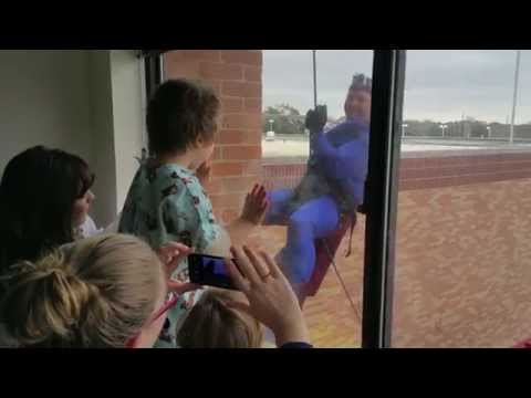 Longview SWAT members rappel down hospital to surprise children