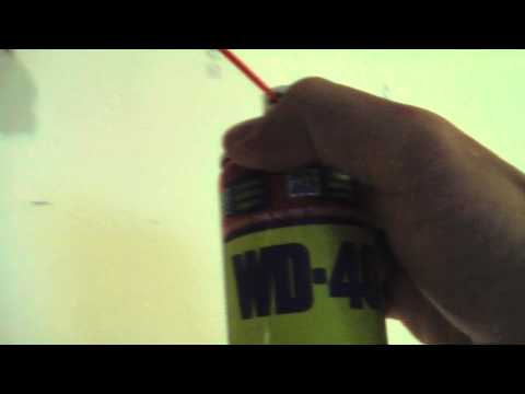 Remove Blu-tack from wall with WD40