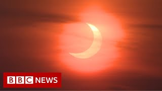 'Ring of fire' solar eclipse lights up sky - BBC News