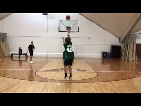 Antoine Griezmann hitting threes on a basketball court in Boston