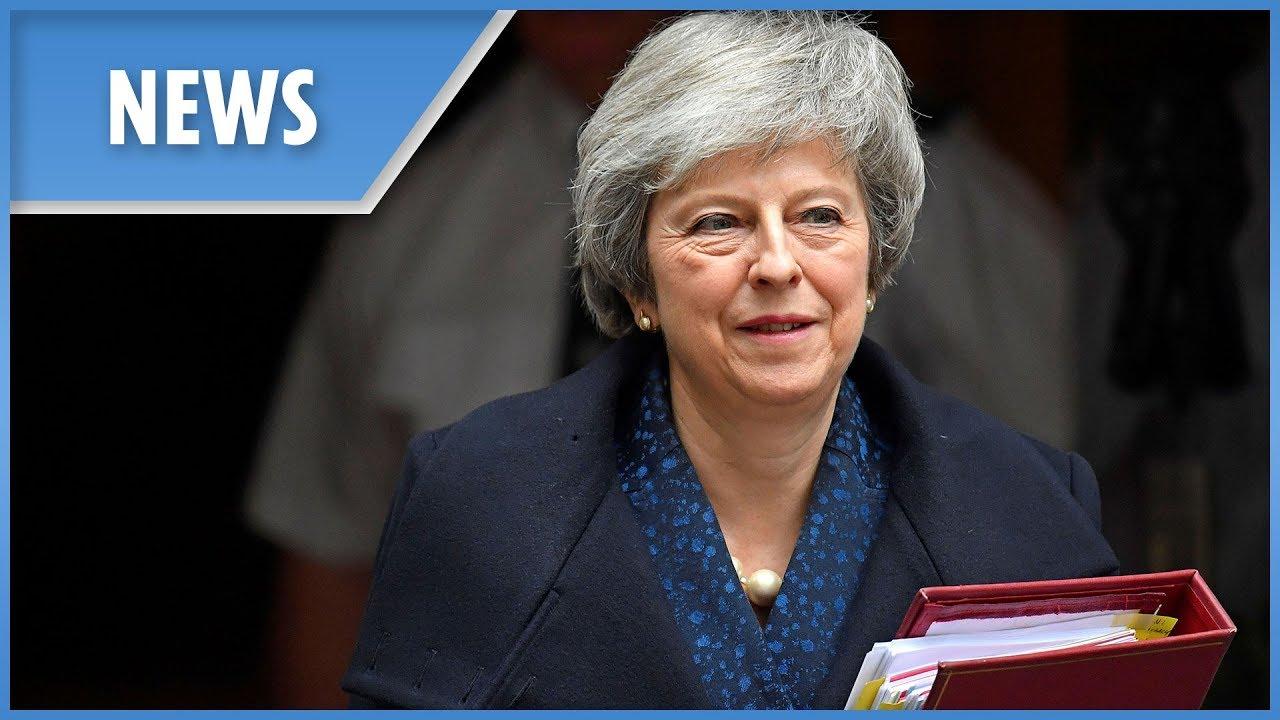Theresa May departs No 10 for PMQs
