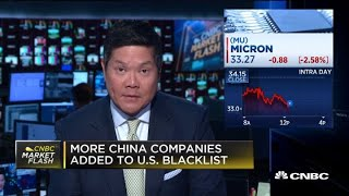 Chip stocks fall after more China companies added to US blacklist