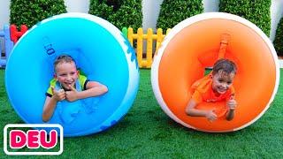 Vlad und Niki spielen outdoor Spiele & Spielzeug und haben Spaß mit Mama