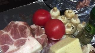 Свинина запечённая под помидорами с шампиньонами и сыром. Рецепт