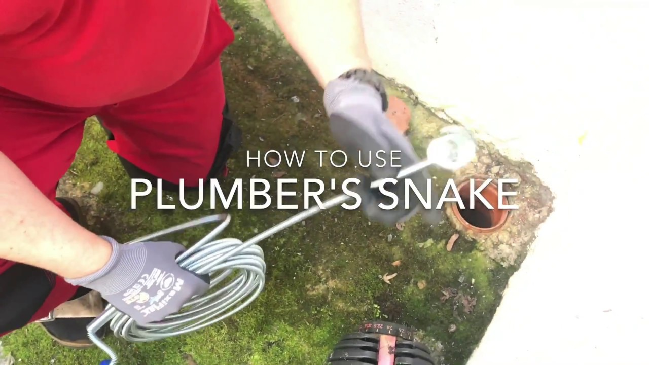 How to use a Plumbers snake to dislodge in plumping clean a drain with a toilet jack DIY