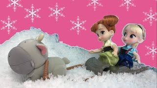 Repeat youtube video Elsa and Anna Toddlers Playing in the Snow! Do you wanna build a Snow Man? + Frozen Surprise Eggs