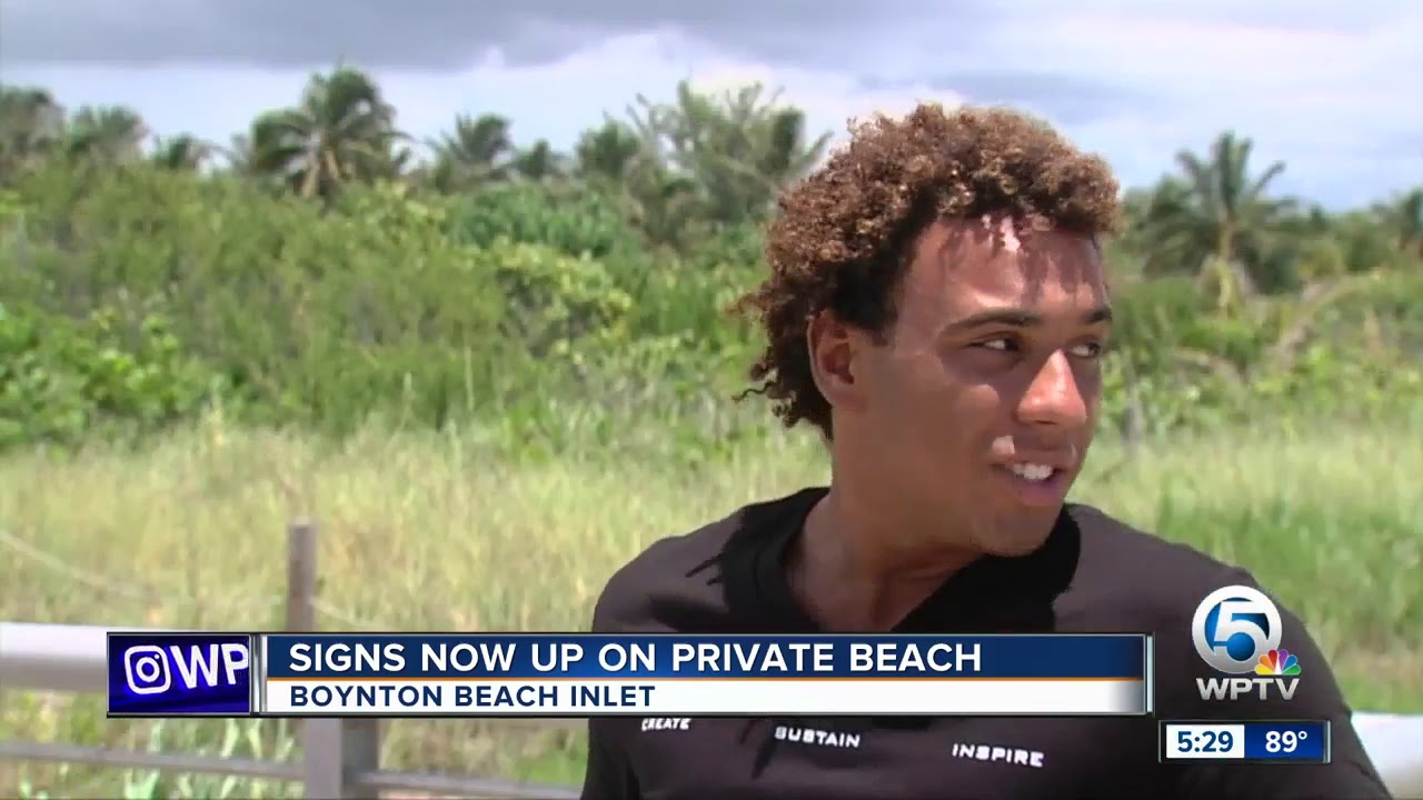 Private property signs up at beach