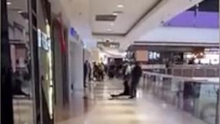 Man tries to throw girlfriend off 3rd floor mall balcony