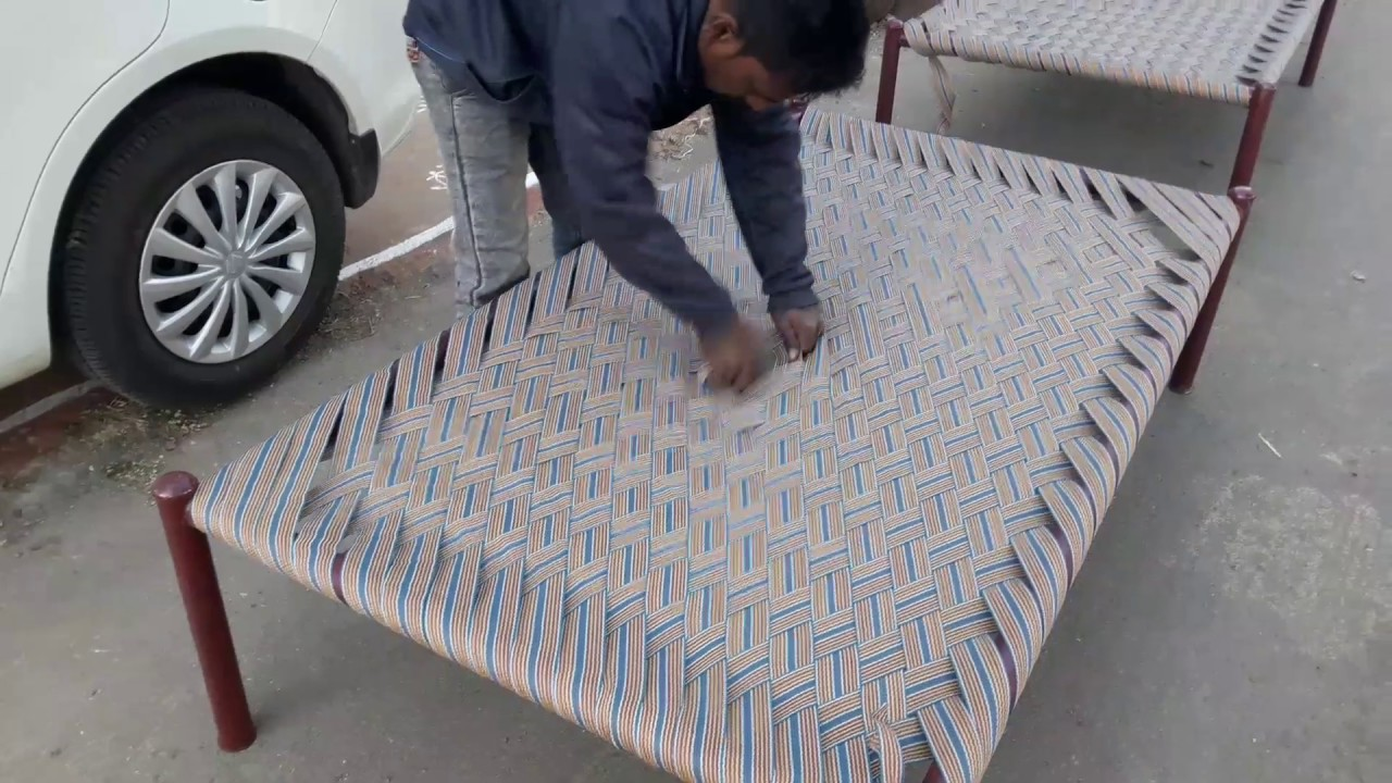 Weaving a charpai bed