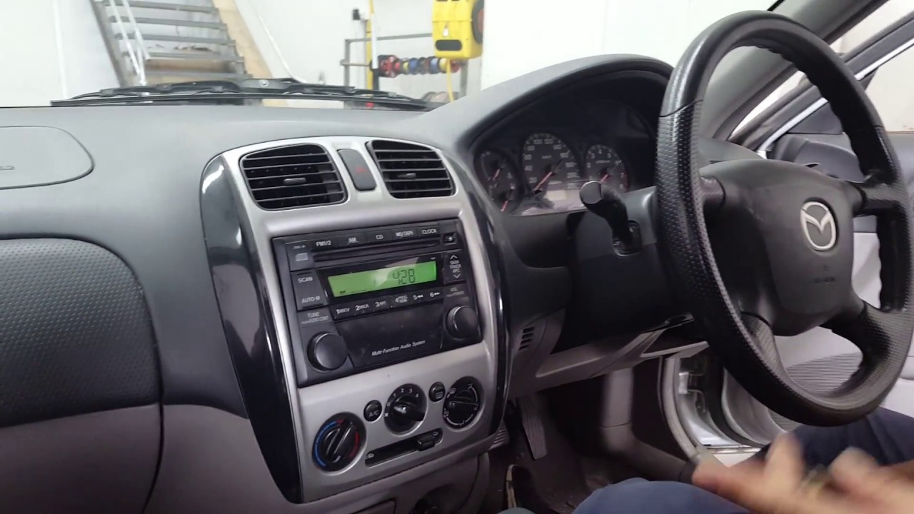 how to install a head unit into a 2003 mazda astina 323