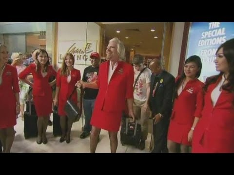 Sir Richard Branson dresses as an air hostess after losing bet with AirAsia chief