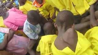 Uganda; Kids drawing on the ground