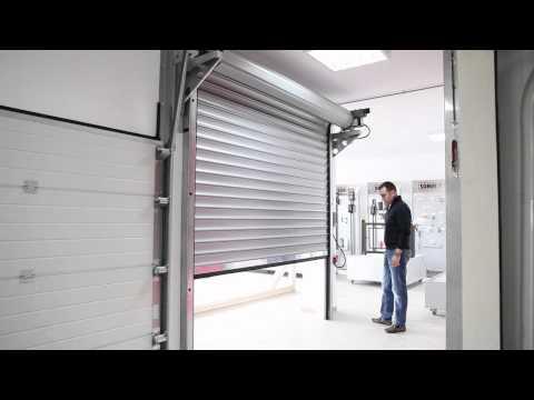 Automatic center pr sente le montage d 39 une porte de gar for Porte de garage mca