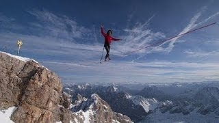 Men Walks on Tightrope Between Two French Alps Mountains