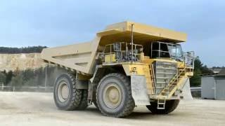 Komatsu HD785-7 trucks heading into quarry after break