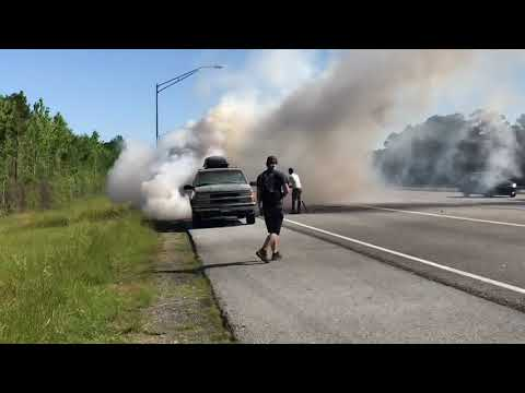 VOLUNTEER FIRE DEPARTMENT ENGINE RESPONDING TO & QUICKLY KNOCKING DOWN A CAR FIRE ON INTERSTATE 95.