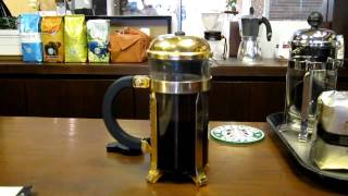 STARBUCKS Shinjyuku Marui Black Apron Store, Serving RESERVE 100% KONA with iced French Press.