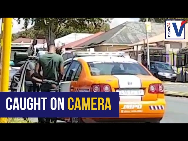 JMPD officers arrested after caught on camera taking bribe