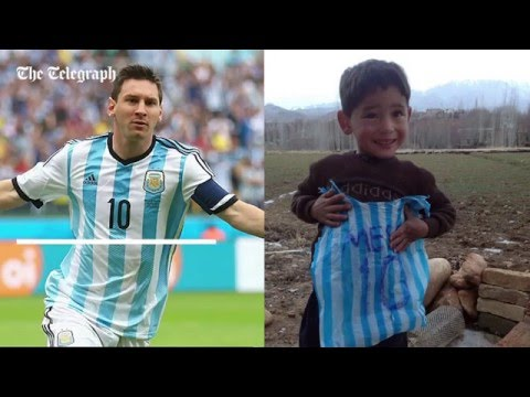Afghan boy with homemade Lionel Messi football shirt filmed playing football
